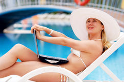 Relaxing near waterpool Royalty Free Stock Image