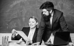 Relaxing before the next class. business couple use laptop and documents. teacher and student on exam. back to school stock image