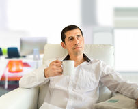 Relaxing at the office with coffee Royalty Free Stock Photography