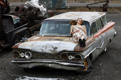 Relaxing on an old car Royalty Free Stock Image