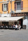 Relaxing out of bar in Brera neighborhood, Milan Royalty Free Stock Photo