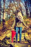 Woman walking in park with umbrella. Relaxing outside concept. Woman walking in park with red umbrella, autumn bright weather Royalty Free Stock Photography