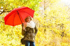 Woman walking in park with umbrella. Relaxing outside concept. Woman walking in park with red umbrella, autumn bright weather Royalty Free Stock Image