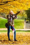 Woman walking in park with umbrella. Relaxing outside concept. Woman walking in park with umbrella, autumn bright weather Royalty Free Stock Photography