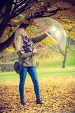 Woman walking in park with umbrella. Relaxing outside concept. Woman walking in park with umbrella, autumn bright weather Royalty Free Stock Photo