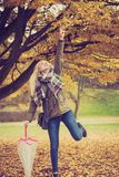 Woman walking in park with umbrella. Relaxing outside concept. Woman walking in park with umbrella, autumn bright weather Royalty Free Stock Image