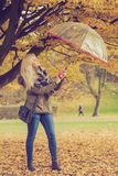 Woman walking in park with umbrella. Relaxing outside concept. Woman walking in park with umbrella, autumn bright weather Royalty Free Stock Images