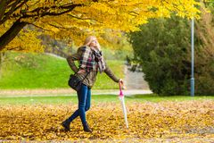Woman walking in park with umbrella. Relaxing outside concept. Woman walking in park with umbrella, autumn bright weather Stock Images