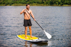 Relaxing on paddleboard. Royalty Free Stock Images