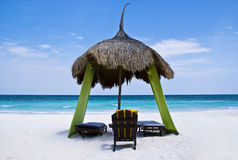 Relaxing palapa, on a tropical beach Stock Photos