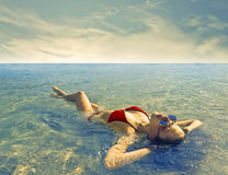 Relaxing in a paradise. A woman is relaxing in a paradise Royalty Free Stock Photo