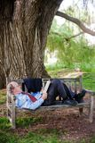 Relaxing on Park Bench Royalty Free Stock Image