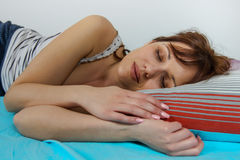 Relaxing and Peaceful Sleeping Woman. Beautiful young woman sleeping in the bed. Relaxing and peaceful Stock Photography