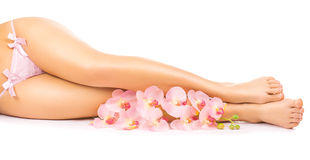 Relaxing pedicure with a pink orchid flower Stock Images
