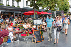 Relaxing people at terraces downtown in the city Antwerp, Belgium Stock Photo