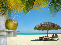 Relaxing people on tropical beach stock image