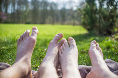 Relaxing on picnic blanket, two person Royalty Free Stock Photos