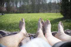 Relaxing on picnic blanket, two person Royalty Free Stock Photo