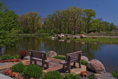 Relaxing place with benches on a lakeshore.  Royalty Free Stock Image