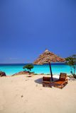 Relaxing point in the beach. Lonely sunshade with 2 beds on the beach, zanzibar africa Stock Photos