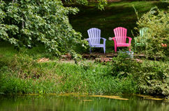 adirondack chairs  by the pond Royalty Free Stock Images