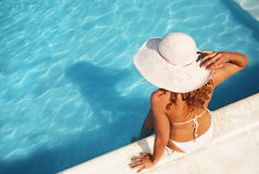 Relaxing at the pool. Woman at a swimming pool Stock Photography