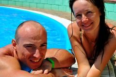 Relaxing in the pool. Happy couple in the pool Royalty Free Stock Image