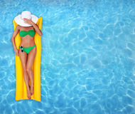 Relaxing in a pool. Woman relaxing in a swimming pool Stock Photo