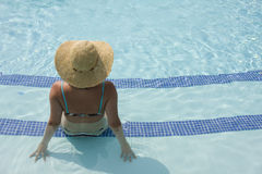Relaxing at the pool Royalty Free Stock Image