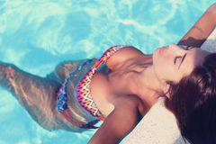 Relaxing in a pool Stock Image