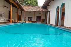Relaxing pool in a colonial garden. Pool in garden in colonial house Stock Photo