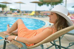 Relaxing at the pool stock images