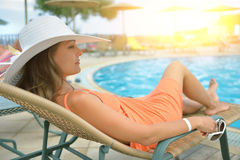 Relaxing at the pool Stock Photography