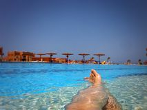 Relaxing in a pool from my point of view Royalty Free Stock Photography