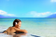 Relaxing pool woman on holidays vacation travel Stock Images