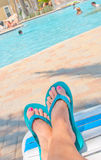 Relaxing at poolside Royalty Free Stock Images