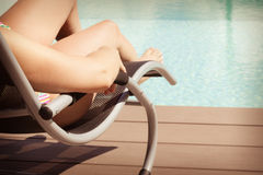 Relaxing at the poolside Stock Images