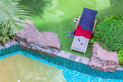Relaxing poolside swimming pool chair. Royalty Free Stock Photos