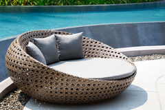 Relaxing Rattan Sofa. At Swimming Pool Royalty Free Stock Photos