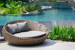 Relaxing Rattan Sofa. At Swimming Pool Royalty Free Stock Photo