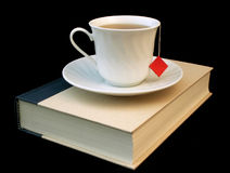Relaxing read 2. Teacup on a closed book royalty free stock image