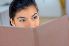 Relaxing by reading book Stock Image
