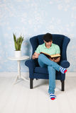 Relaxing and reading at home Stock Photos