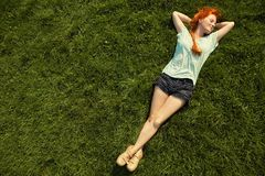 Relaxing redhead girl royalty free stock image