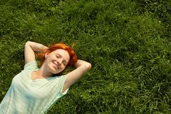 Relaxing redhead girl stock image