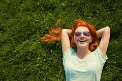 Relaxing redhead girl stock images