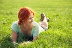 Relaxing redhead girl stock photo