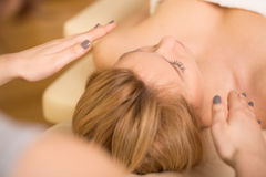 Relaxing during reiki healing. Beauty blonde woman relaxing during reiki healing royalty free stock photo