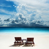 Relaxing on remote beach with could. Relaxing on remote beach with raining cloud stock images