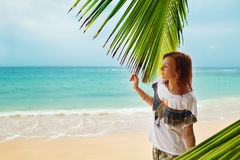 Relaxing on remote beach, Sri Lanka. Young woman relaxing on the beach, Sri Lanka Stock Image